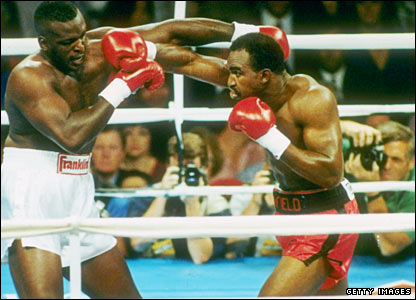 "Evander Holyfield (r) fights ""Buster"" Douglas"