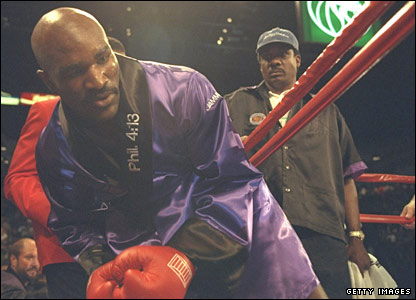 Evander Holyfield enters the ring to face Mike Tyson