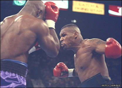 Mike Tyson on the attack against Evander Holyfield