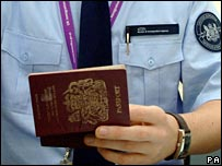 Immigration officer checks a passport