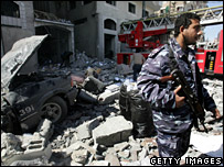 A member of Hamas inspects the damage of the air strike on the interior ministry building in Gaza (28 February 2008)