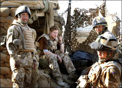 prince harry pictures. Prince Harry sits with a group