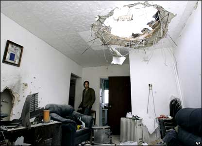 Israelis inspect the damage to a flat after a rocket fired by Palestinian militants in the Gaza Strip hit the town of Ashkelon.