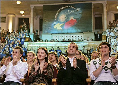 Dmitry Medvedev (second from right) attends comedy rally