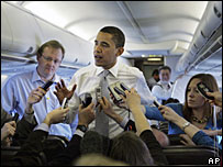Barack Obama speaking aboard his campaign plane (Photo: AP/Rick Bowmer)