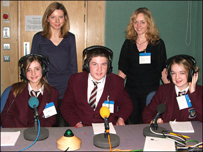 Three Strangford College students with headphones and microphones
