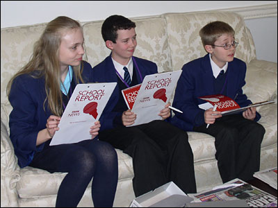 School Reporters from St Bernard's Catholic Grammar School in Slough with their School Report clipboards sitting on a sofa at the Cabinet Office