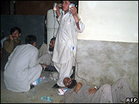 Pakistanis injured in a suicide attack lie on a hospital floor in Mingora, 29 February 2008