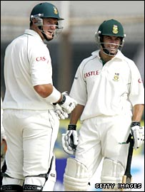 Smith (left) and McKenzie celebrate their record opening stand.