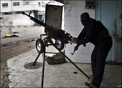 Hamas militant with machine gun - photo 1 March