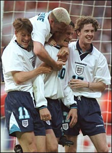 Sheringham's England team-mates celebrate his goal against Holland