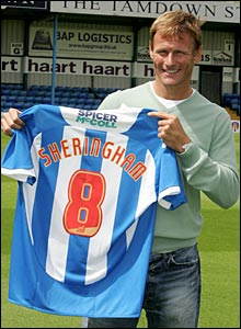 Sheringham poses with a Colchester shirt