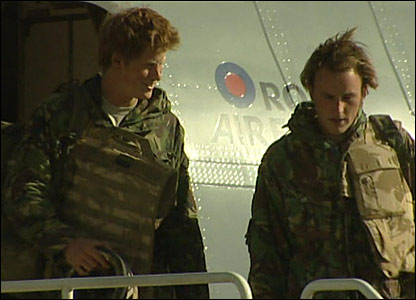 Prince Harry on steps of plane