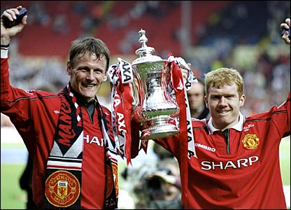 Teddy Sheringham and Paul Scholes celebrate with the FA Cup in May 1999