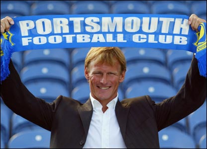 Teddy Sheringham holds up a Portsmouth scarf