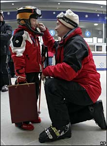 Putin talks to small boy at ski resort near Sochi on the Black Sea in February 2008