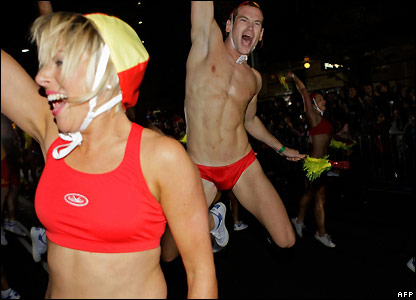 Participants in Sydney's gay and lesbian Mardi Gras parade wearing swim suits