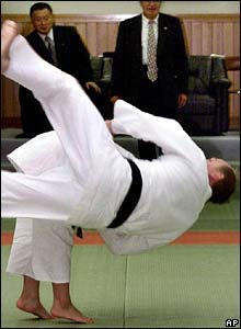 Mr Putin is thrown by a Japanese schoolgirl in Tokyo in September 2000