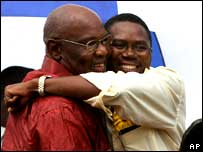 Dumiso Dabengwa (L) gets a hug from Simba Makoni at the launch of their presidential campaign, at a rally in Bulawayo