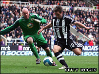 Rovers keeper Brad Friedel and Newcastle's Michael Owen