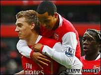 Nicklas Bendtner is congratulated by Theo Walcott