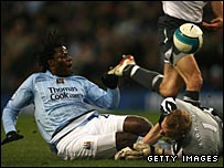 Wigan keeper Chris Kirkland saves from Manchester City's Benjani