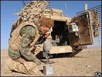 Prince Harry eats breakfast in the desert of Helmand Province