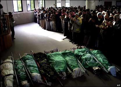 The bodies of eight militants from Hamas are seen as mourners pray in a mosque during their funeral in Jebaliya