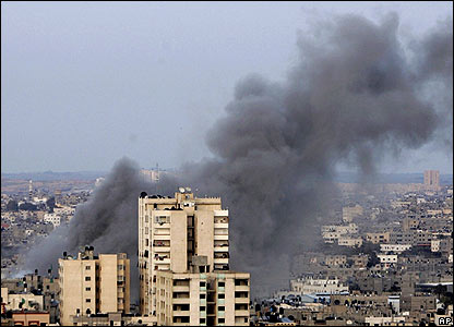 Smoke rises after an Israeli air strike.