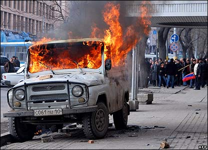 A car burns near an opposition demonstration in Yerevan on 1 March
