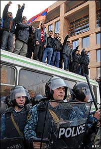 Police stand by as opposition supporters shout slogans in central Yerevan on 1 March