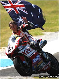 Troy Bayliss celebrates his victories in front of his home fans.