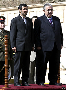 Mahmoud Ahmadinejad (left) and Jalal Talabani stand for the national anthems of the two countries - 2 March 2008