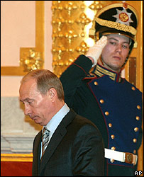 Outgoing President Vladimir Putin and Kremlin guard