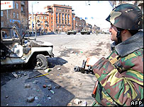 Armenian riot policeman and burnt-out car in Yerevan - 2 Mar 08