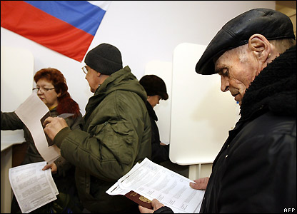 Russians examine their ballot papers at a polling station in Moscow