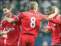 Xabi Alonso (left), Steven Gerrard (centre) and Ryan Babel celebrate during the win at Bolton