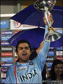 India captain Virat Kohli receives the under-19 World Cup