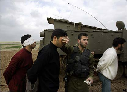 Israelis hold captured Palestinians at the Gaza border - 2 March