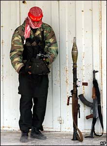Palestinian militant during Israeli operation in Jabaliya refugee camp - photo 2 March