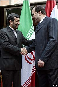 Iranian President Mahmoud Ahmadinejad (left) shakes hands with Iraqi Prime Minister Nouri Maliki on 2 March