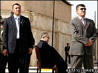 Iraqi President Jalal Talabani (centre) waits for Mr Ahmadinejad's arrival at his residence