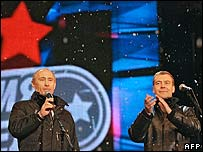 Vladimir Putin (left) appears with Dmitry Medvedev at a Moscow rock concert on 2 March.