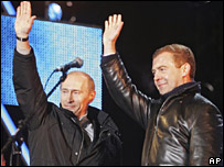 Vladimir Putin, left, and his hand-picked successor Dmitry Medvedev greet their supporters