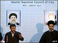 Mahmoud Ahmadinejad (left) speaks alongside Abdel Aziz al-Hakim in Baghdad