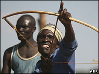 Kalenjin man fires bow and arrow (from 03/02/2008)