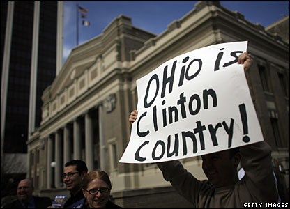 "A Clinton supporter holds up a banner saying ""Ohio is Clinton Country"" in Columbus, Ohio"