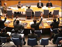 Members of the UN Security Council vote through new sanctions on Iran on Monday
