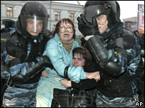 Riot police detain people while dispersing an unsanctioned protest in Moscow on Monday 3 March 2008