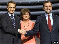 Jose Luis Rodriguez Zapatero (L), moderator Olga Viza, and Mariano Rajoy